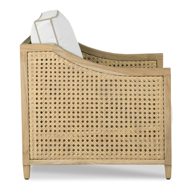 This classic design features a teak frame with woven powder coated aluminum cane. Upholstered in Sunbrealla Canvas White...