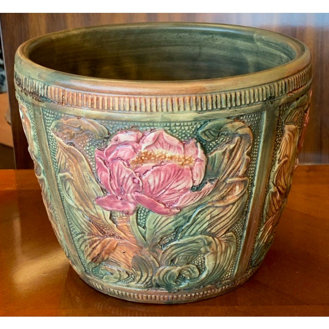 Weller Pottery Flemish jardiniere or cachepot The design is divided into 4 panels each filled with a large pink blossom...