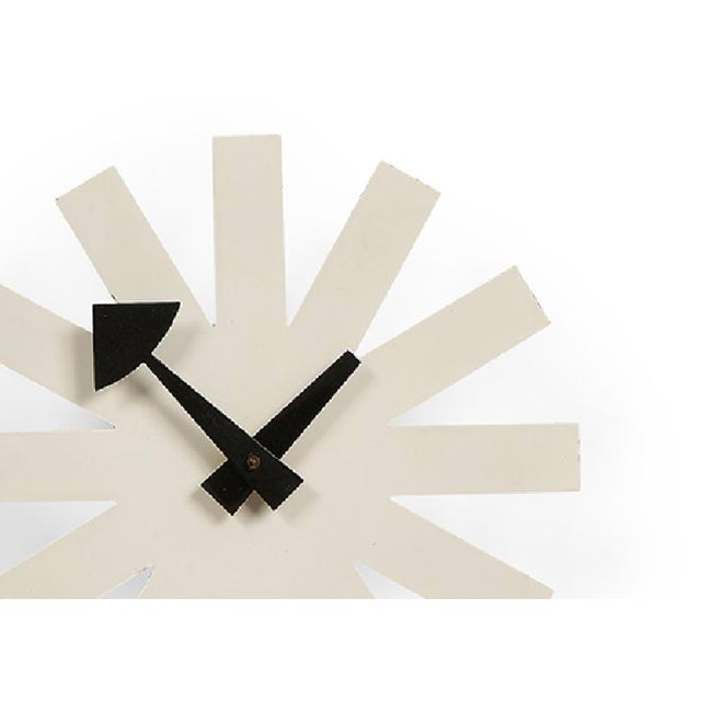 George Nelson Associates white model 2213 Asterisk clock for Howard Miller Clock Co. Zeeland, Michigan. Fabricated from...