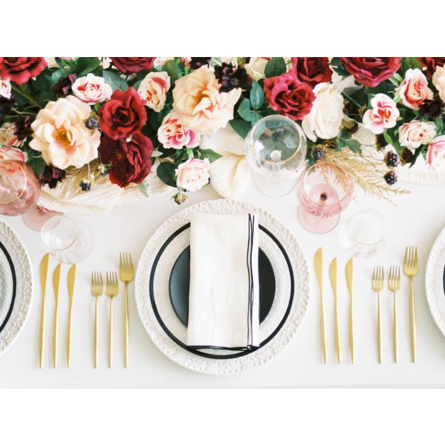 This linen napkin is the perfect addition to any formal setup. Its made with pure linen and has a contrasting edge that...