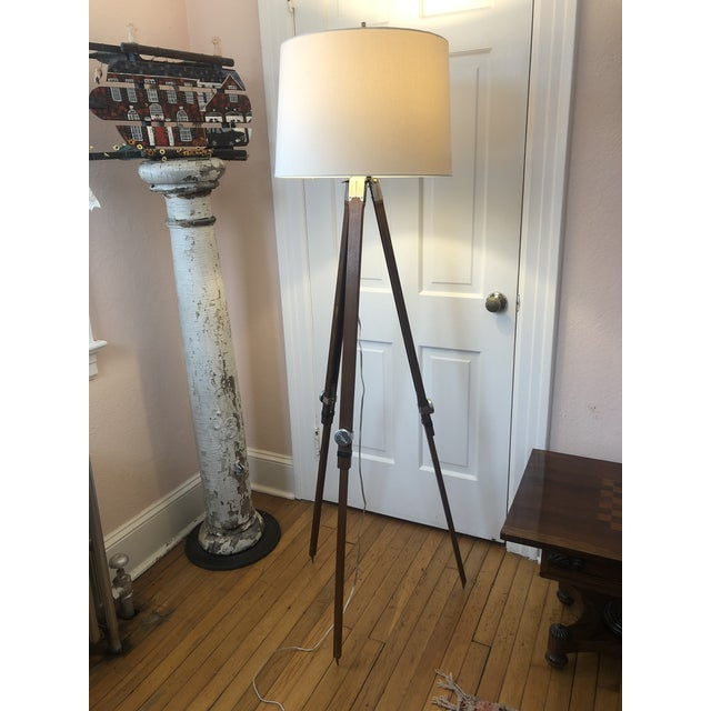 A handsome wood and chrome tripod surveyors stand made into a classic floor lamp.