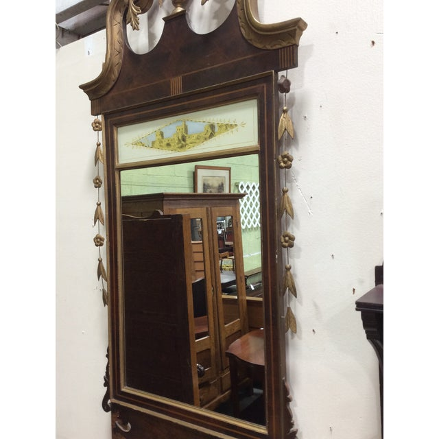 A beautiful mirror in the Hepplewhite style (1780-1800) but made c1910 and probably retailed by Paine Furniture in Boston....