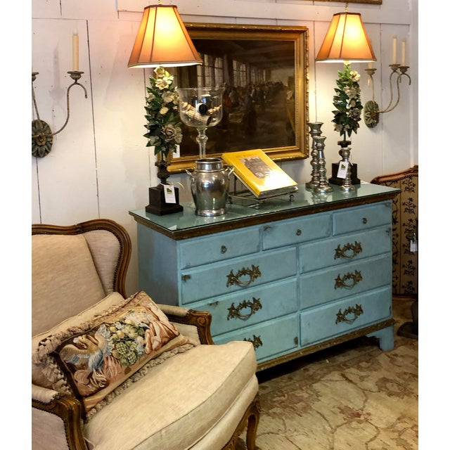 A glammed up vintage solid wood large chest of drawers, faux painted a fabulous shade of blue, with gilded decoration and...