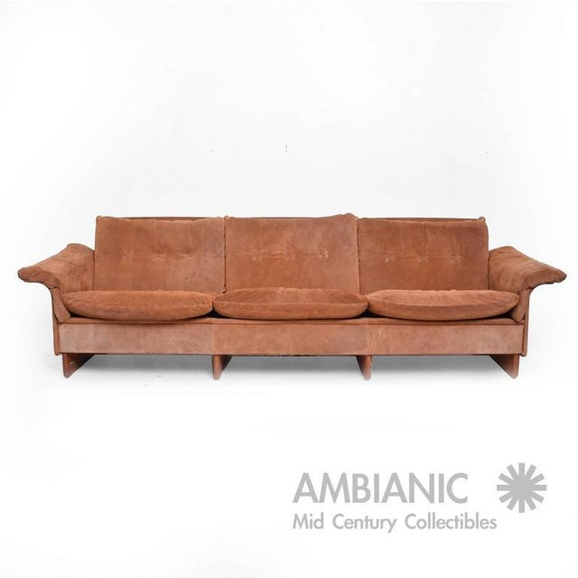 For your consideration a Danish modern sofa constructed with suede in medium brown tones with teakwood. Stamped made in...