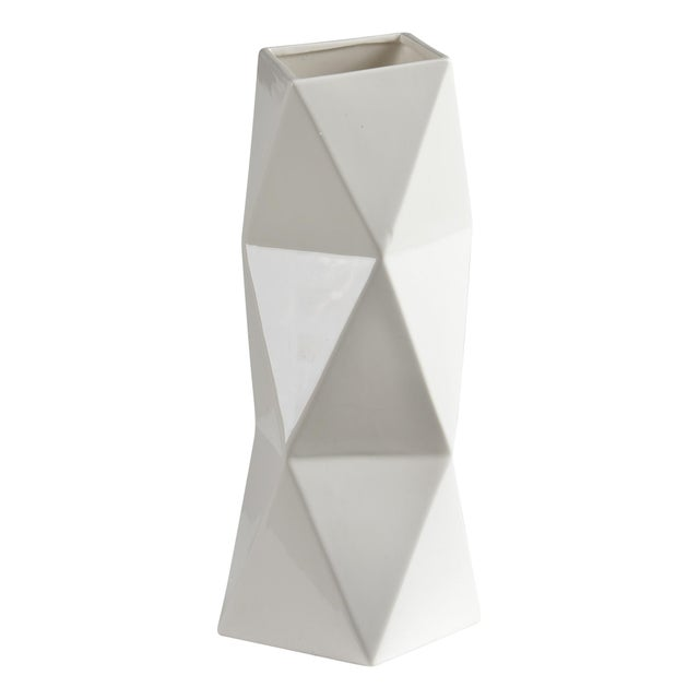 East meets west influences inform the angular shape of this modern tabletop accessory. Sculpted and smoothed from natural...