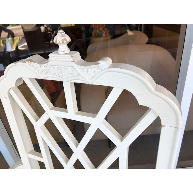 For sale beautiful pair of Chinoiserie Pagoda top arm chairs. Fret Works on the back and arms. Great addition for a...