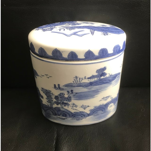 Classic Chinoiserie style ceramic box with scenes of the Chinese countryside. Made in the late 20th century.