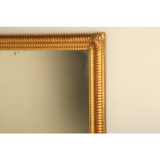 Antique French water gilded mirror from Toulouse, that has not required any restoration, other than to touch up a corner...