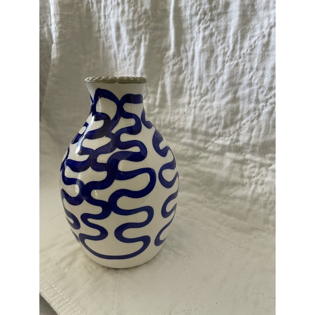 Adorable blue and white vase. Ceramic and perfect to brighten any room.