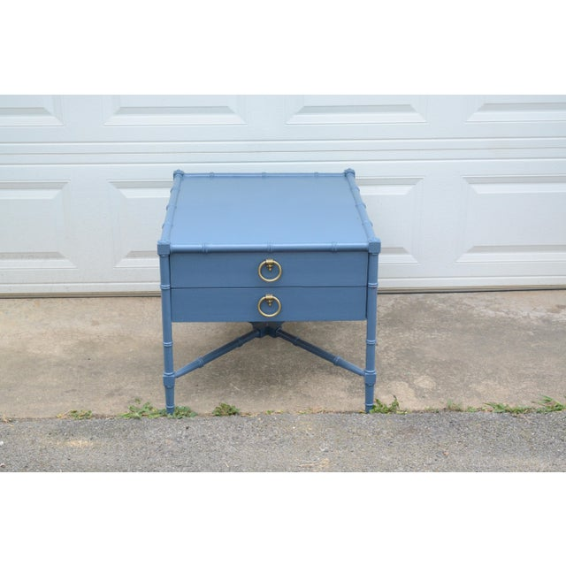 Vintage, Heritage Grand Tour Faux bamboo wooden end table in high gloss navy. It has original brass hardware and two...