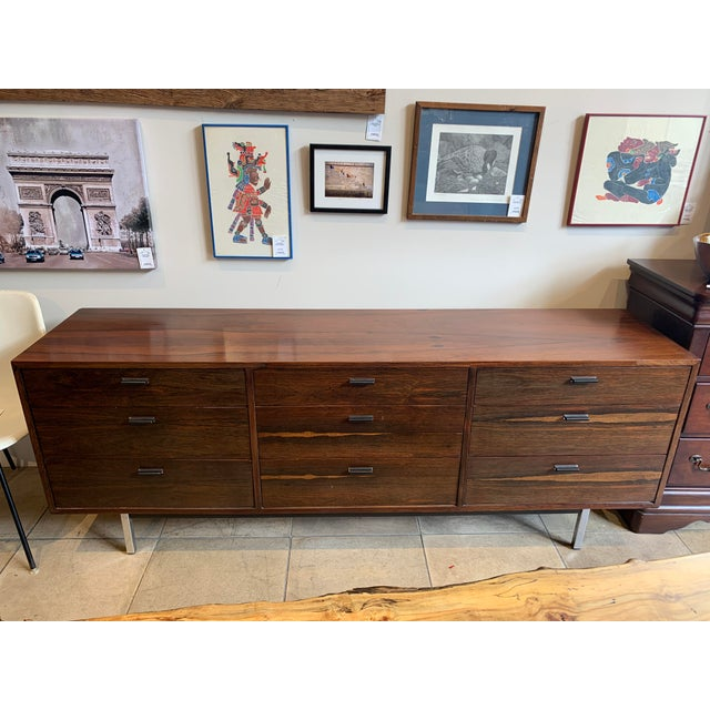 Mid-century modern dresser styled after the unique furnishings of Florence Knoll, features 9 drawers of varying sizes and...