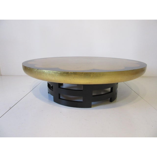 A Lotus gold leaf and ebony finished coffee table manufactured by the Kittinger Furniture company . Well constructed and...