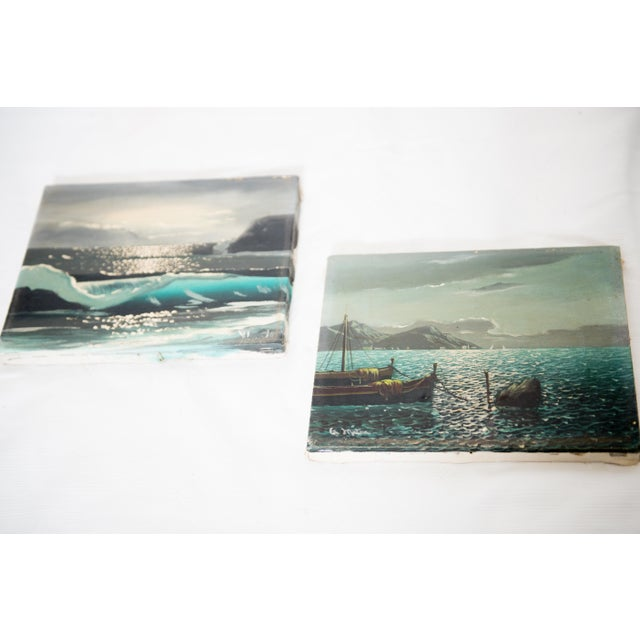 Pair of vintage oil on canvas paintings depicting the Bay of Naples, Italy. One depicts moored boats set against Mount...