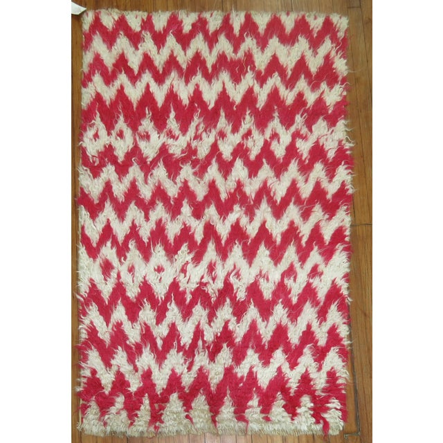 One of a kind Turkish Tulu shag rug in ivory and bright pink. A great piece to add to your decor!