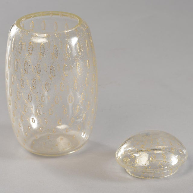 Circa 1950s clear Murano glass vessel has gold inclusions and a lid. Other similar vessels in other sizes and shapes...