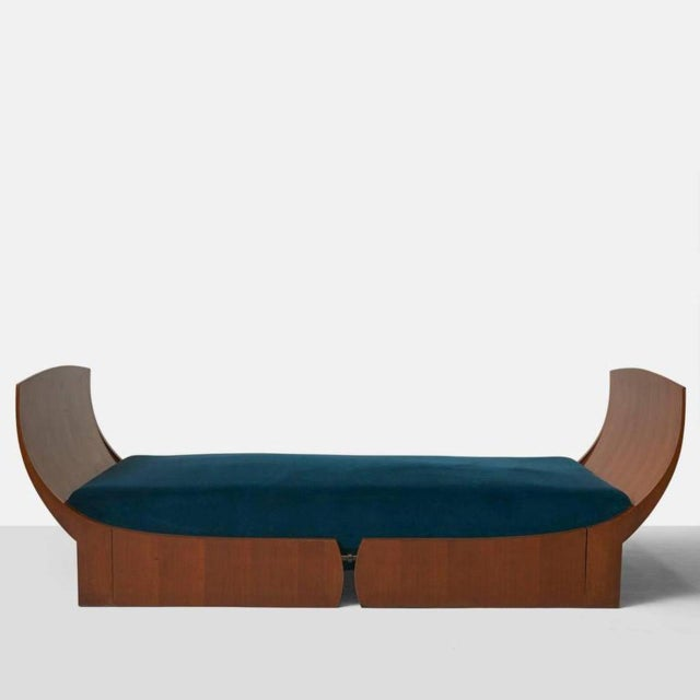 A classic and elegantly shaped walnut daybed by Luigi Caccia Dominioni and one of four only known examples. The bed is...
