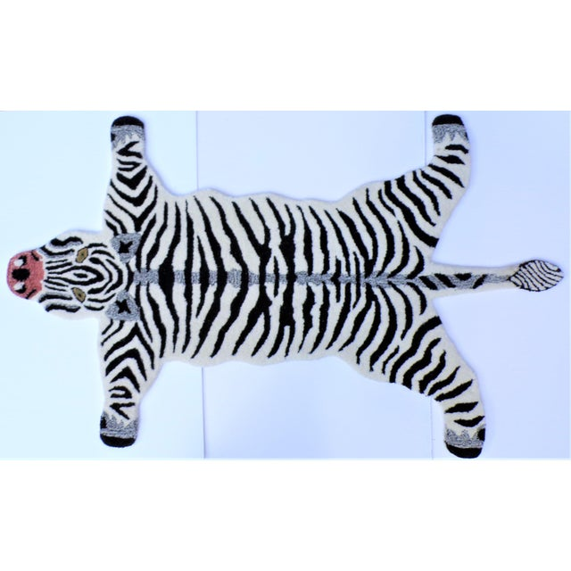 This is a whimsical rug in the shape of a black and white Zebra. It is called a Persian hunting rug and they are often...