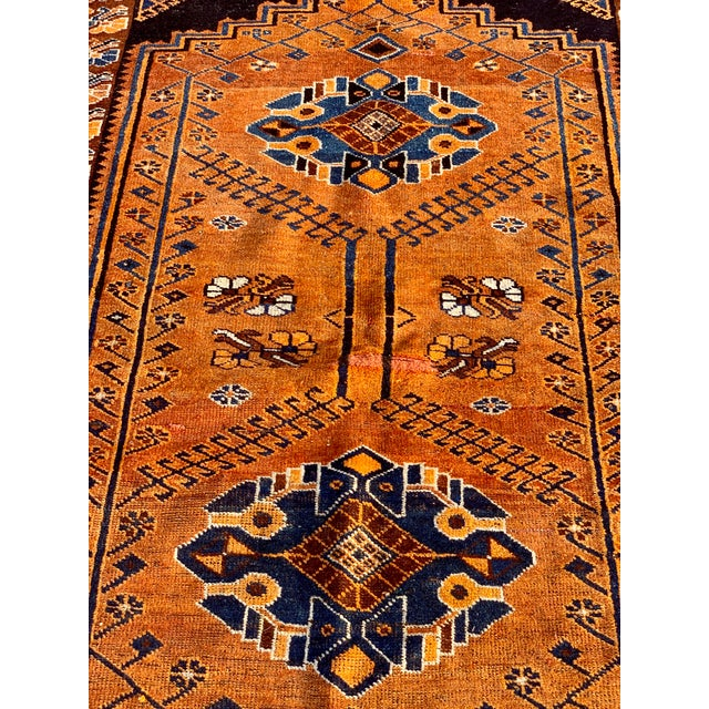 This is a vintage Kurdish rug. The piece was made in the 1930s.