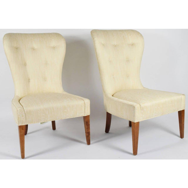 This is an elegant pair of chairs upholstered in a softly patterned silk and linen.