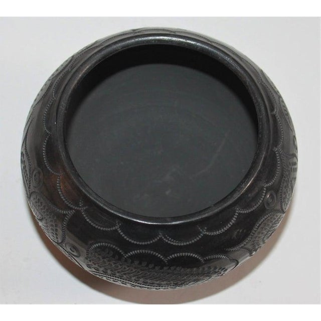Signed Navajo Indian pottery bowl in fine condition. The black glazed pot.