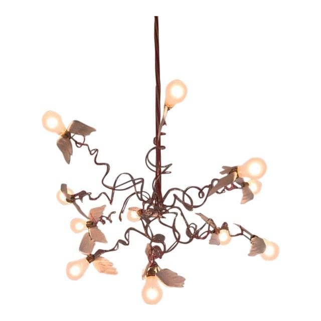 Ingo Maurer birdie chandelier: Classic edition with fed electrical wire. The Ingo Maurer Birdie Chandelier was designed by...