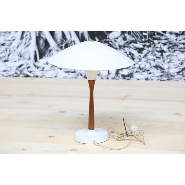 In the style of Finnish designer Paavo Tynell's Chinese Hat Table lamp, this table lamp has a beautiful combination of...