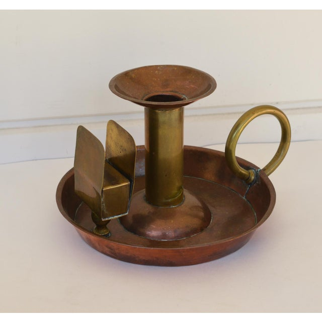 This is a fabulous large antique copper candle stick holder. It features a large bowl with a match box holder attached....