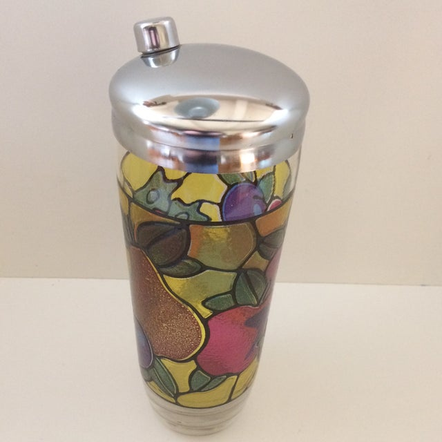 Colorful mosaic pattern on this 1970's cocktail shaker features strawberries, plums, pears, and apples. It is a 24 Oz....