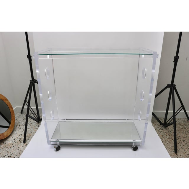 This custom designed Lucite bar cart was created by the firm of Alexander Millen. Note: Showroom Sample for Bespoke/Custom...