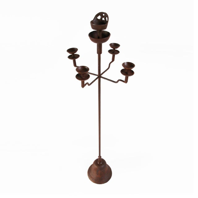 Vintage iron Shanxi candle stand in medium size. These are available in medium and large size. Each is sold separately....