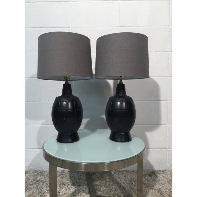Pair of Mid Century Plasto Mfg. lamps in Black Lacquer. Keep it simple and classy with Black and Gray. Lamps have new...