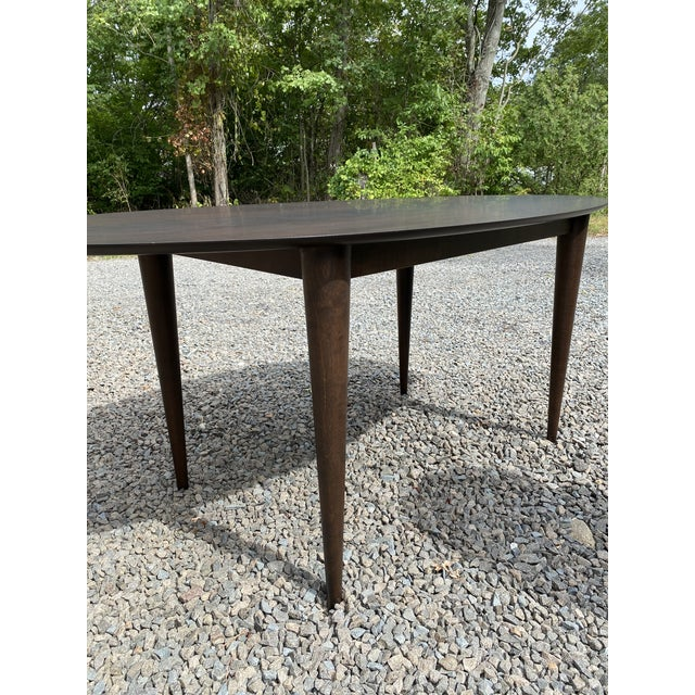 This modern table is perfect for any living space. It adds a nice touch to any room and really stands out. It's perfect...