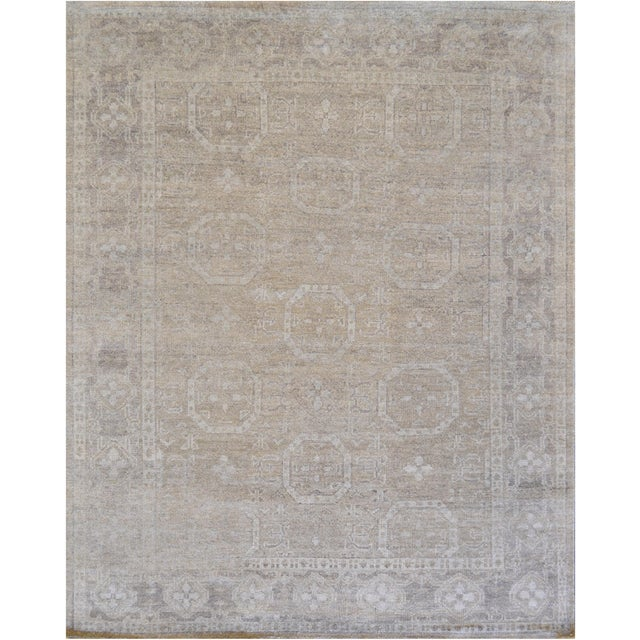 A beautiful Tabriz from Kashmir featuring a decortive all-over pattern with updated colors. 100% natural wool pile. Brand...