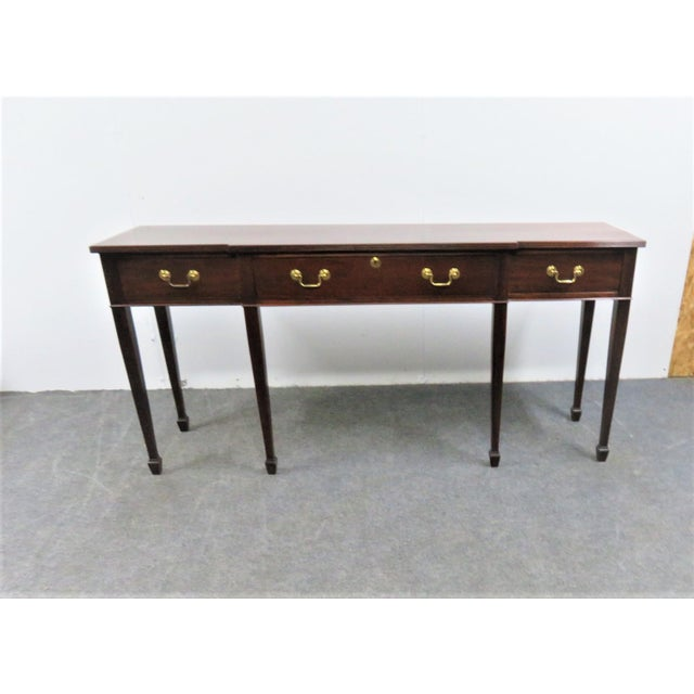 Solid Mahogany Hepplewhite sideboard made by Madison Square , 3 drawers, center drawer felt lined with flatware organizer