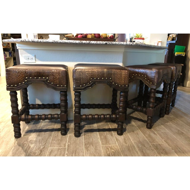 NEW- **Available in bar and counter height** Made of handcrafted solid wood, brown leather, and crocodile embossed. Tied...