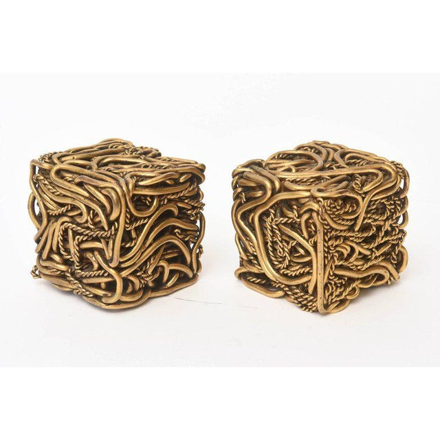 These amazing and fabulous pair of signed French bronze square cube sculptures are meticulously intertwined works of...