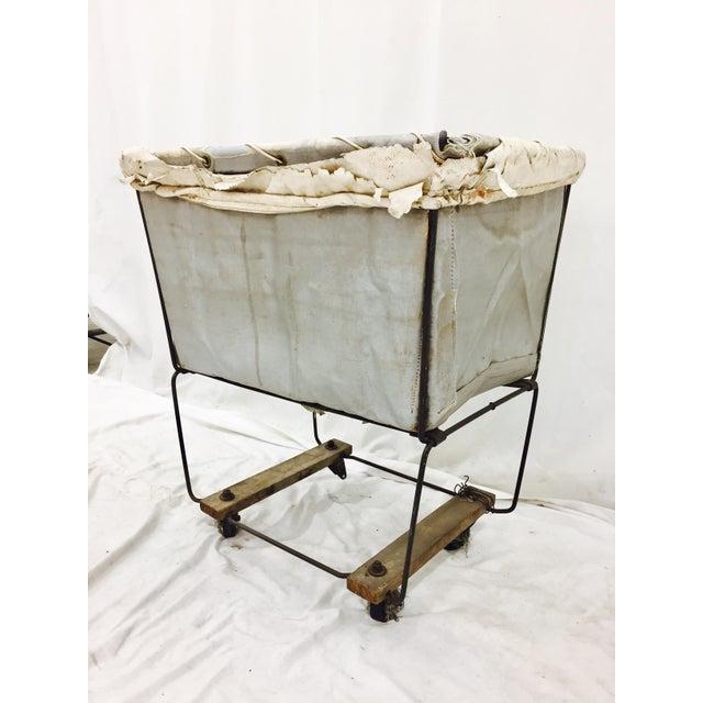 "Vintage Laundry Basket with wood & metal frame. Cart rolls. Wonky back wheel. Needs repair. 26"" x 19"" x 29"" Basket..."