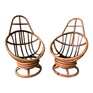 Pair of Mid Century Rattan Swivel Lounge Chairs For Sale