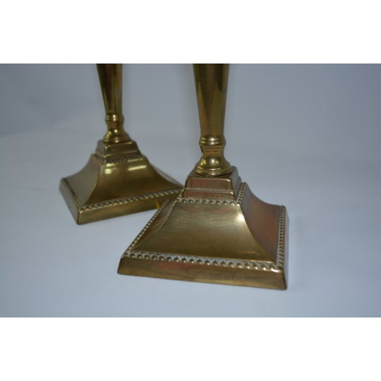Beautiful pair of brass candlestick holders. Perfect for any tabletop space and the interior designer.