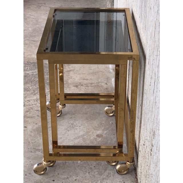 Brass Nesting Tables Italian Design 1970 in Brass With Smoked Glass and Wheels - a Pair For Sale - Image 8 of 11