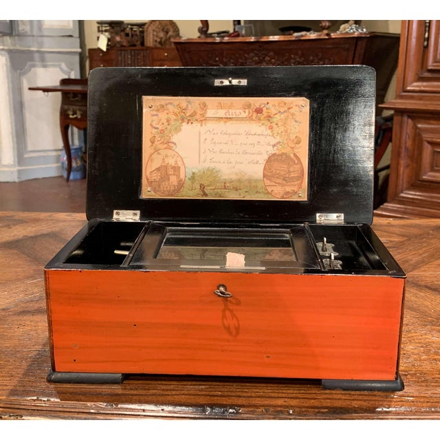 Listen to soft, cheerful music in your living room with this traditional, antique music box. Crafted in Paris, France...
