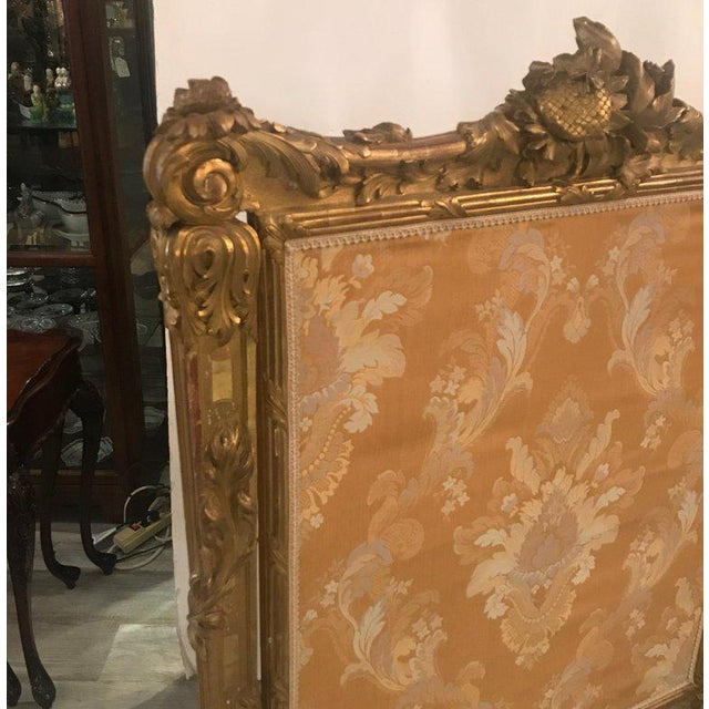 The most spectacular large fire screen with original high-low gilding. The remarkably detailed surround with expert...