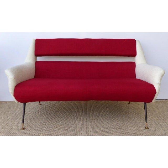 This circa 1960 midcentury Italian settee by Gigi Radice newly upholstered with a two-tones of wool. The settee is...