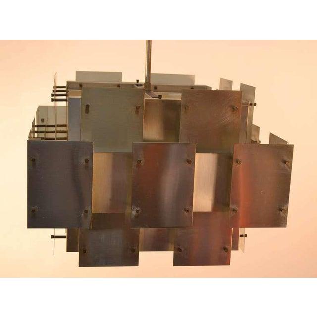 Modernist sheet steel and brass fixture, by Robert Sonneman. Large and impressive.