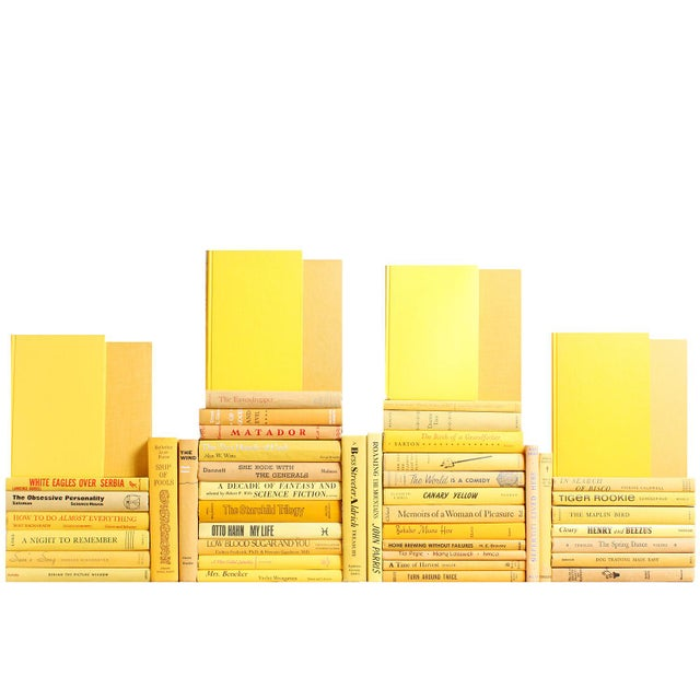 The Midcentury Yellow Book Wall features fifty midcentury era books in warm and vibrant shades of yellow. Gold, blonde and...