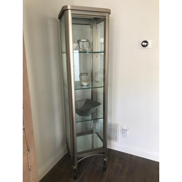 Gorgeous Ethan Allen Radius Collection brushed nickel collection. All 4 sides are glass on 4 rubber wheels. Dimensions:...