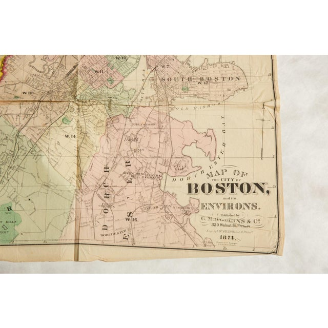 :: Antique folding map of the city of Boston Massachusetts and its environs, published by G.M. Hopkins & Co. in 1874. Map...