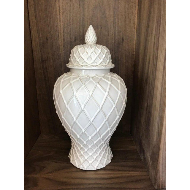 Hollywood Regency large pottery ginger jar with lid has gorgeous urn form with white glaze finish. Features both Chinese...