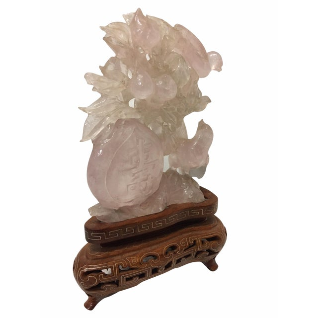 Beautiful Chinese carved rose quartz sculpture depicting several birds set on a fitted wood base.