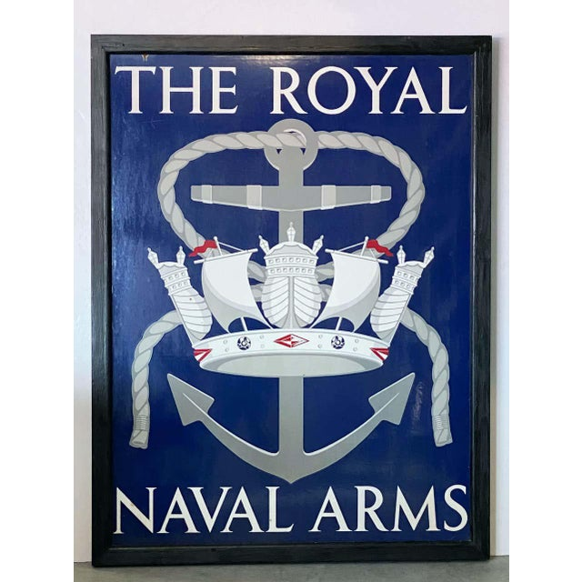 An authentic English pub sign (one-sided) featuring a painting of a stylized royal crown of ships and sails super-imposed...